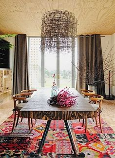 Unique oak table, textiled rug and quirky lighting. #interior #decor