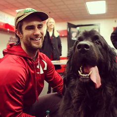 Awww. Red Wing Patrick Eaves and his buddy, Rueben, meet and greet friends from the Michigan Humane Society.
