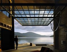 I want this house. The wheel on the right opens the window.  Chicken Point Cabin // Tom Kundig
