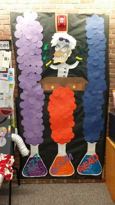 My bulletin board for Fizz, Boom, Read! Kids get a game piece (rocket ship or robot) and move up the potions' bubbles as they read.