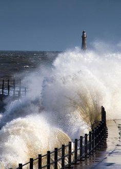 *Waves crashing by lighthouse at Sunderland, England