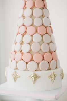 blush macaron tower with a splash of gold