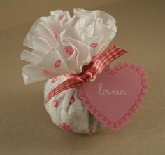 Coffee filter favors. Cute & cheap! $1 store filters & stamps could go a long way with a small budget. Genius!