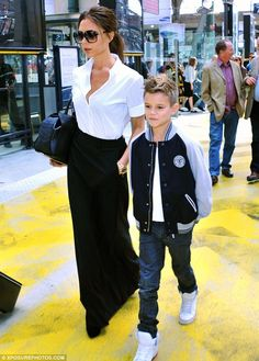 Just in: Victoria Beckham and son Romeo arrived at Gard du Nord, Paris,