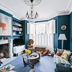 Cosy eclectic London living room teal walls see to make the pretty moulding stand out. They just need to bring the furniture off the walls and into the room a bit more. Chandelier not low enough for me. Teal Living Rooms, Home And Living, Living Area, Living Room Decor, Living Spaces, Peacock Living Room, Modern Victorian Decor, Victorian Living Room, Victorian Interiors
