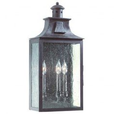 Classic European design with an Old Bronze finish and Clear Seeded glass make the Newton collection one of our most popular. Free Shipping. Shown in Old Bronze finish with Clear Seeded glass. Hand-Forged Iron fixture from Troy Lighting. Takes 1 Candelabra bulb.