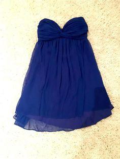 Blå kort klänning från Nelly.com i storlek 36 - 99 kr