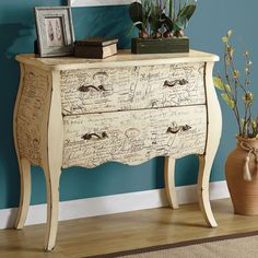 This French vintage styled accent cabinet features a scripted case with a scalloped apron, tall cabriole legs, twisted brass hardware and an aged white distressed wood finish. Two large drawers provide ample space for storing photo albums, candles and personal belongings. Create the perfect accent in your home when you feature this two drawer occasional cabinet.