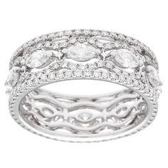 <li>Marquise and round white diamond eternity band</li> <li>18k white gold jewelry</li> <li><a href='http://www.overstock.com/downloads/pdf/2010_RingSizing.pdf'><span class='links'>Click here for ring sizing guide</span></a></li>