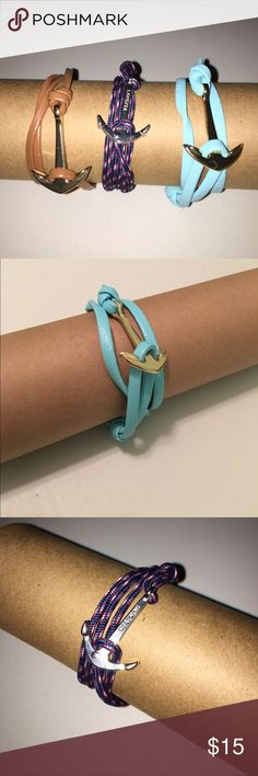 SALE! Lot of 3 Anchor Bracelets! One Brown Leather Bracelet with a Gold Anchor Clasp • One Blue Leather Bracelet with a Gold Anchor Clasp • One Red, White, and Blue Nylon with a Silver Anchor Clasp with the brand Vikings stamped onto the front. Vikings Jewelry Bracelets