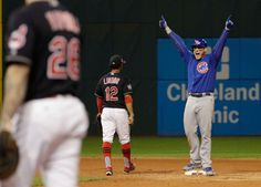 Chicago Cubs' Anthony Rizzo reacts after teammate Kris Bryant scored on Rizzo's hit during the fifth inning of Game 7 of the Major League Baseball World Series against the Cleveland Indians Wednesday, Nov. 2, 2016, in Cleveland.