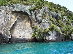 Lake Taupo, New Zealand, with Maori stone carvings.