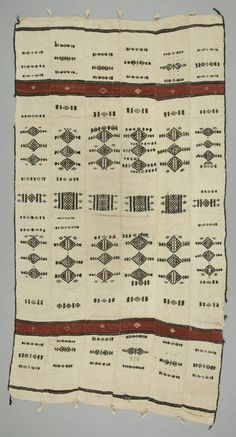 Blanket for the Bed, Fulani 	c 1980 	L 256 cm x W 128 cm  - The Fulani people of West Africa are known for their woven blankets, or khasa, made of wool from the sheep they herd. The Fulani use these blankets to protect themselves from the cold and mosquitoes during the cold and humid seasons, respectively. Women spin the wool and dye it, and men weave the cloth on horizontal, narrow strip, foot-treadle looms and sell it in the markets. Khasa are sold in Mali, Nigeria and Senegal.
