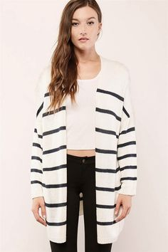 We love this classic stripe knit with an open front, a longline silhouette, slightly oversized fit, ribbed trim, long sleeves, dropped shoulders, and on-seam side pockets.  It's a perfect fall (or spring) layer-friendly essential that will carry you throughout the cooler seasons in style.  For winter weather, just add this piece under your go-to coat to stay extra cozy, warm and, of course, chic.