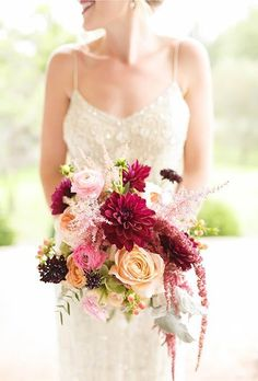 A bright, natural bouquet comprised of dahlias, garden roses, ranunculus, berries, astilbe, and amaranthus, created by George's Flowers.