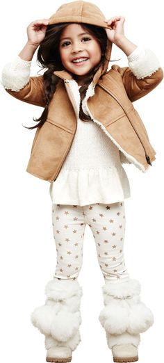 Our little star knows how to stay warm in Old Navy Faux-Fur Pom-Pom Boots.