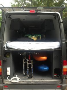 Underbed storage easily fits 2 mountain bikes (with floor fixed for mounts) and 2 whitewater kayaks