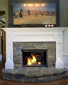 Fireplace mantel in white with stacked stone surround set a top ...