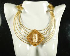 http://www.cristaisaquarius.com.br/comprar-bijuterias-com-pedras/capim-dourado.html