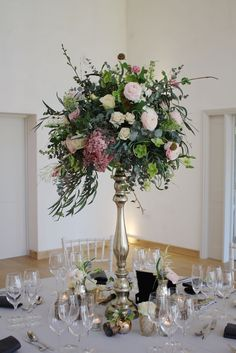 This sort of idea for the gold /brass tall candlestick arrangements but using all your bright colours.   Created by Hannah Berry Flowers www.hannahberryflowers.co.uk http://www.millbridgecourt.co.uk