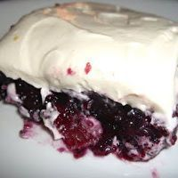 Blueberry Congealed Salad 2 pkgs (3 oz.) grape jello 2 cups boiling water 1 (16 oz.) can crushed pineapple 1 (16 oz.) blueberry pie filling 8 oz. cream cheese 1 cup sour cream 1/4 cup sugar 1 t vanilla extract