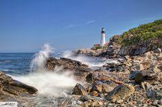 Wave Crashing around Lighthouse | portland-maine-head-light-lighthouse-from-shore-rocks