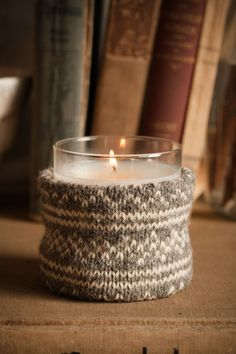 Votive candle cozy using part of a sweater. Would make a easy, cheap, but adorable gift.
