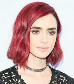 Lily Collins's deep red hair and bold brows are stunning