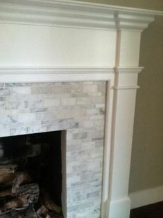 tile fireplace surround. want to redo fireplace like this!