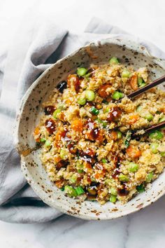 15 Minute Cauliflower Fried Rice - healthy + clean fried rice made with cauliflower, carrots, onions, garlic, eggs/tofu, and sesame oil! 180 calories per serving. Vegetarian / vegan / gluten free.   pinchofyum.com