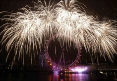 Ferris Wheel at New Year time, London fireworks, England