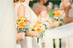 Bridesmaids in tan dresses with neutral and orange bouquets by Stephanie Messick photography via MarryandBright.com