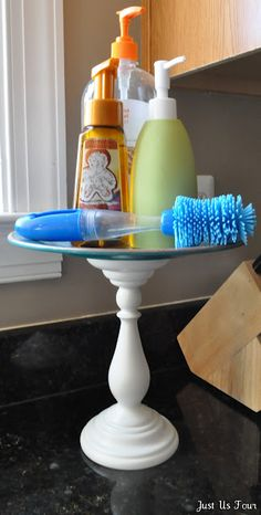 candlestick and plate made into quick cake stand... Cassie we should have a craft night and do all the Pinterest stuff we have found to decorate your house lol!