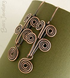 Antiqued copper Egyptian coil earrings  featuring by BooJewels
