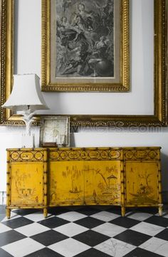 black & gold... the credenza is gorgeous. love it with the black and white floor. love the frame within a frame.