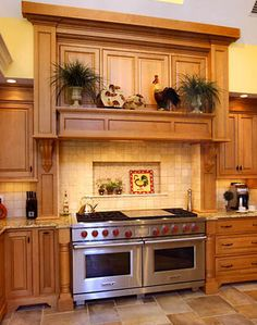 Double Oven Range, Extra Storage and Work Space Traditional Kitchen Cabinets