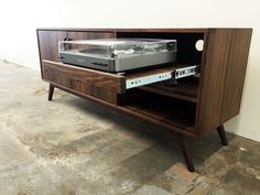 Mid century modern TV console, record player pull out by MonkeHaus on Etsy https://www.etsy.com/listing/291823337/mid-century-modern-tv-console-record