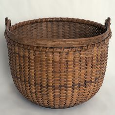 "A 7"" open round Nantucket lightship basket with cane staves and wooden ears.   C.1890, unknown maker.   For more information please email us or call 508-228-0960."