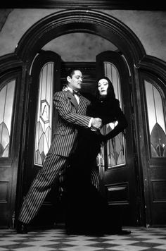 Raul Julia as Gomez and Anjelica Huston  as Morticia Adams in The Addams Family Movie.