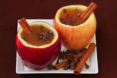 mulled apple cider in apple cups. definitely trying this in the fall!