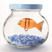 Thanks to magnets hidden under the lid, this goldfish shimmies, quivers, and floats in its jam-jar bowl just like the real thing.