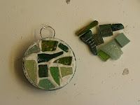 Mosaic hanging decorations and jewellery with recycled lids!