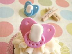 Get step-by-step instructions to create fondant pacifier toppers to embellish your cupcakes and sweet treats, perfect for baby showers!