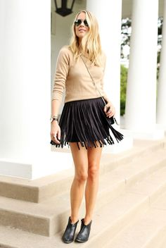 fall / winter - street style - street chic style - casual outfits - fall outfits - black fringe mini skirt + camel sweater + black booties + black shoulder bag + black aviator sunglasses