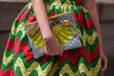 NYFW Spring 2014 Street Style - African inspired print dress with silver glitter clutch