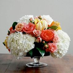 white hydrangea with coral flowers