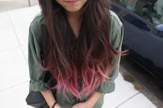 Brown hair with pink tips.