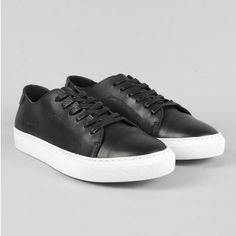 """Garment Project  Black Lace Sneaker: This Garment Project's classic lace-up, low-top sneaker features the """"athleisure"""" trend with cushioned comfort and timeless style.  Smooth uppers in premium leather, tonal laces, subtle logo detailing to the tongue, contrast pumped-up sole and premium leather lining for comfort in every step."""