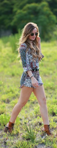 Bohemian patchwork romper styled with a double buckle belt and lace up boots, perfect festival outfit