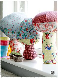 fabric mushrooms- kinda anthropolgie looking. They could also be used as pillows.